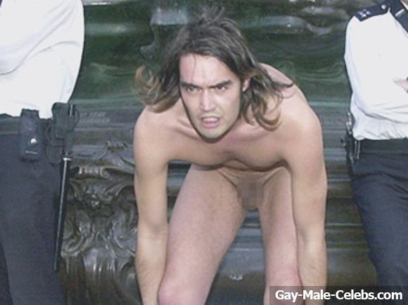 Russell brand photographed naked on balcony