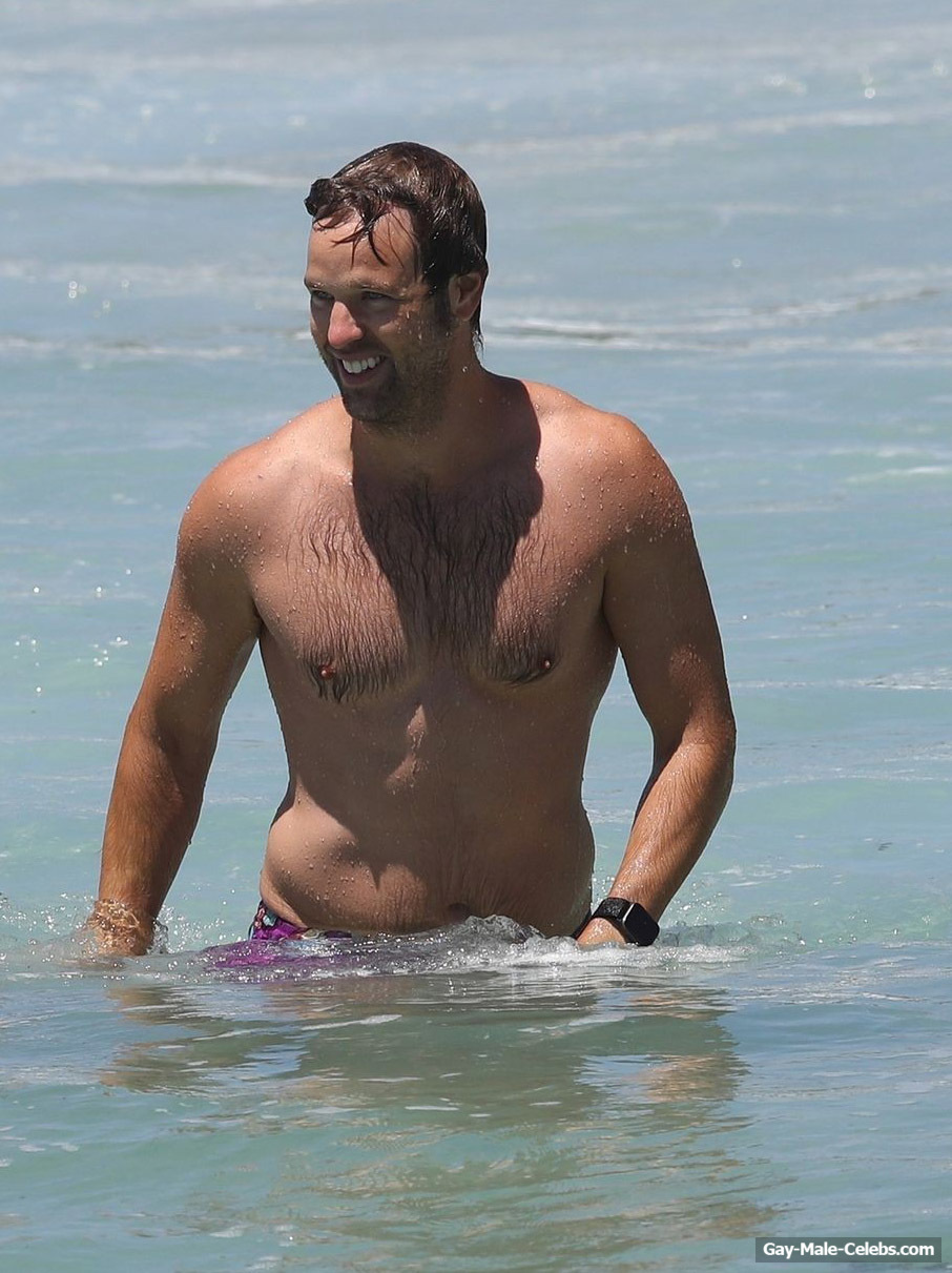 Danny Clayton Sunbathing Shirtless On A Beach